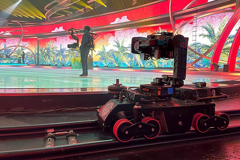 NEWTON stabilized remote head on both skating cameraman and Ross Furio rail camera dolly in TV broadcast