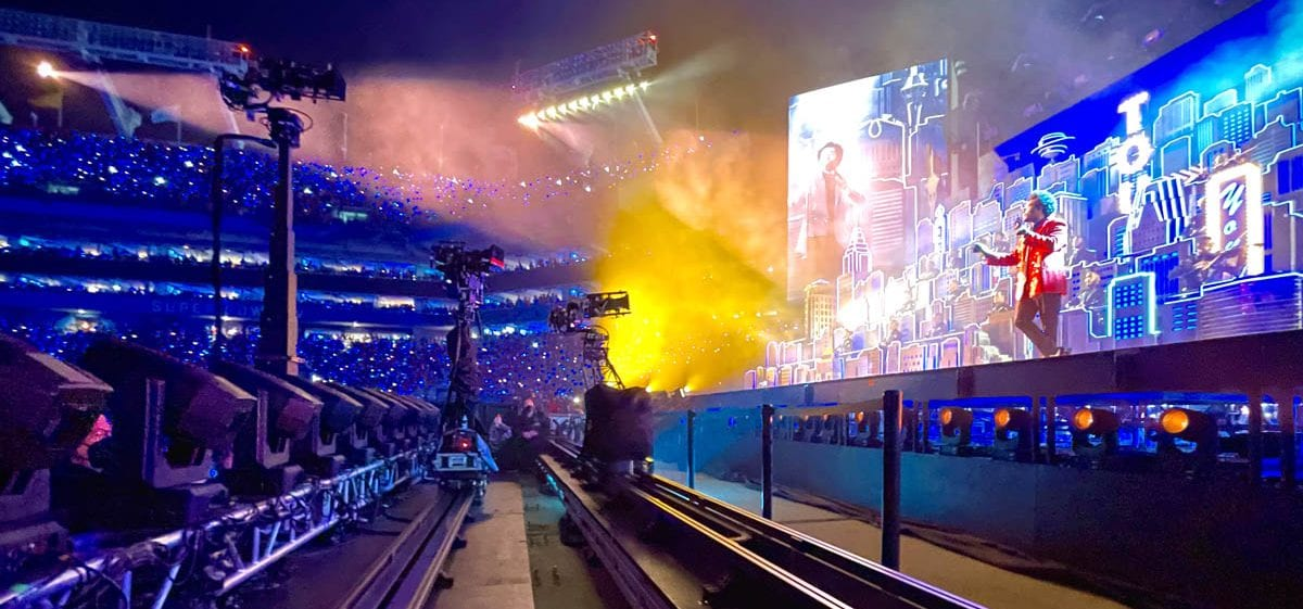 NEWTON S1 stabilized remote head with Arri Alexa Mini on telescopic tower remote dolly camera system at live TV broadcast of Superbowl halftime Weeknd show